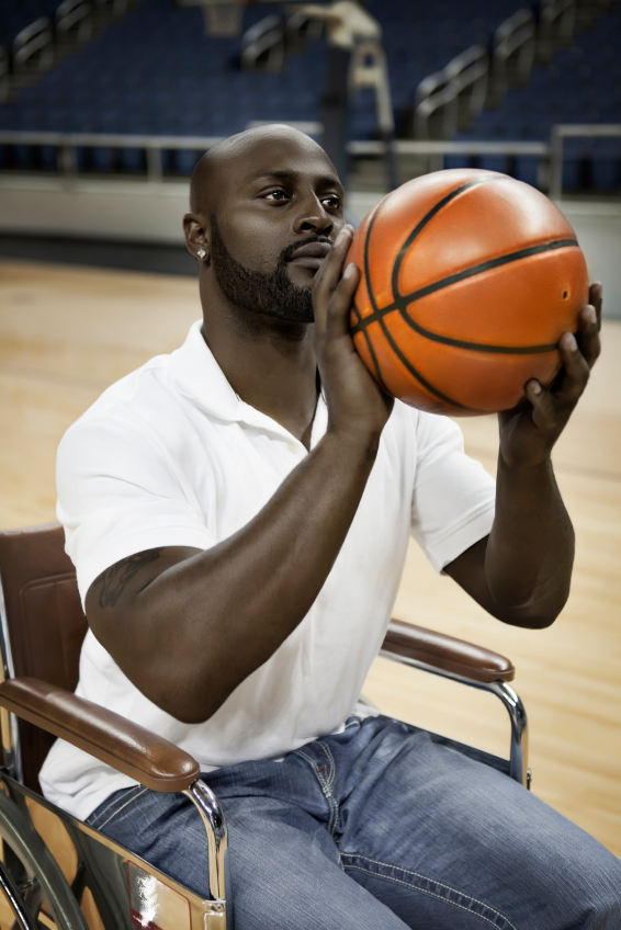 A wheelchair basketball player posts up for a free throw during a practice.